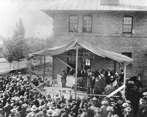 W.A. Richards reads the proclamation at the grand opening of the land office at Provo, Utah on August 17, 1905. (WSA Sub Neg 21408)